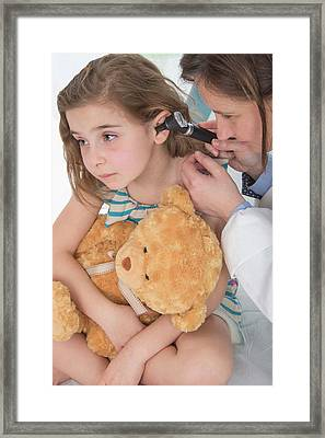 Girl Having Her Ears Examined Framed Print by Lea Paterson