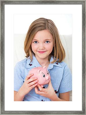 Girl Holding A Piggy Bank Framed Print by Lea Paterson