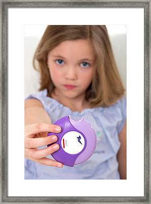 Girl Holding Asthma Medication Framed Print by Lea Paterson