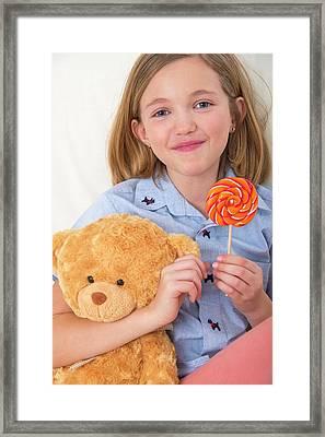 Girl Holding Lollypop And Teddy Bear Framed Print
