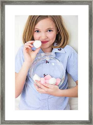 Girl Holding Marshmallows Framed Print by Lea Paterson