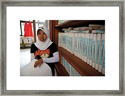 Girl In A Braille Library Framed Print by Matthew Oldfield