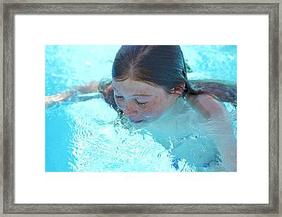 Girl In A Swimming Pool Framed Print
