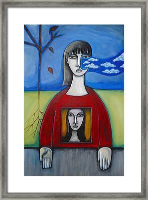 Girl In The Window Framed Print by Roy Guzman