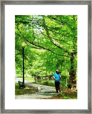 Girl Jogging With Dog Framed Print by Susan Savad