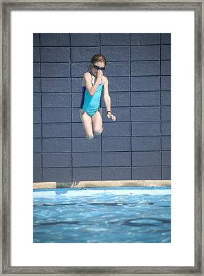 Girl Jumps Into The Pool Framed Print