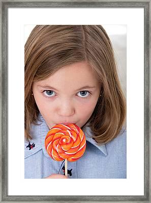 Girl Licking A Lollypop Framed Print