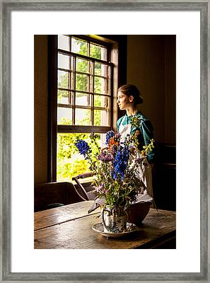 Girl Looking Through An Open Window  Framed Print by Levin Rodriguez