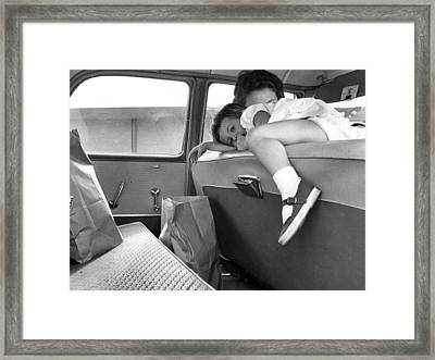 Girl Looks Into Backseat Framed Print by Retro Images Archive