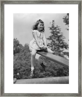 Girl On A Seesaw, C.1940-50s Framed Print by H. Armstrong Roberts/ClassicStock