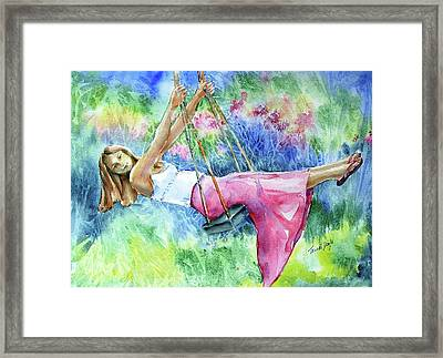 Girl On A Swing  Framed Print by Trudi Doyle