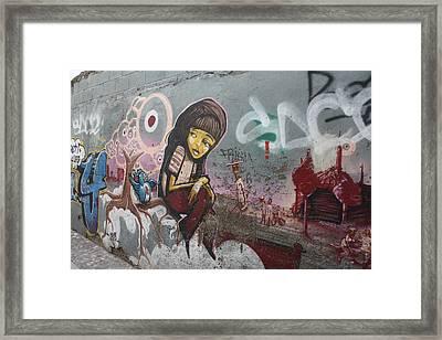Girl On A Wall Framed Print by Jan Katuin