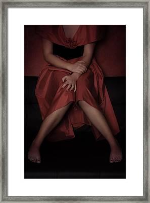 Girl On Black Sofa Framed Print