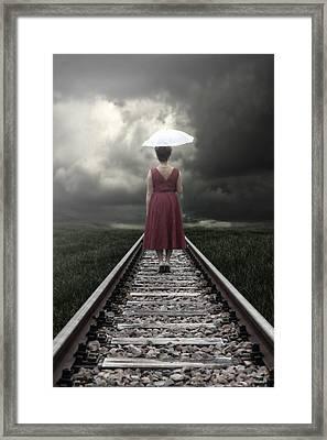 Girl On Tracks Framed Print by Joana Kruse