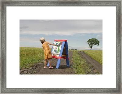 Girl Painting In Field Framed Print by Mirek Weischel