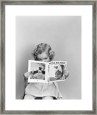 Girl Peeking Over Little Bo-peep Book Framed Print by H. Armstrong Roberts/ClassicStock