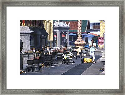 Girl Praying In Front Of Buddhist Temple Near Chang Mai Framed Print by Richard Berry