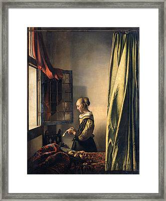 Girl Reading A Letter By An Open Window Framed Print by Johannes Vermeer