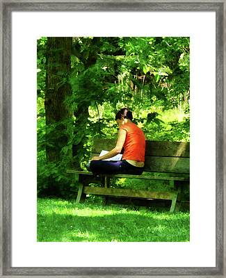 Girl Reading In Park Framed Print by Susan Savad