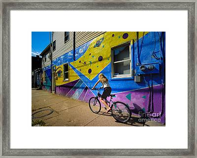 Girl Rides Bicycle Past Mural On The South Side Of Pittsburgh Framed Print