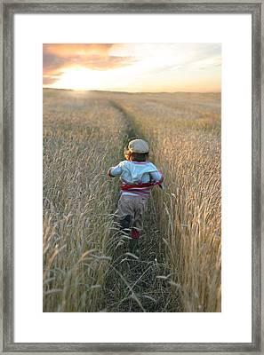 Girl Running Through Wheat Field Framed Print