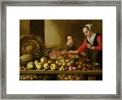 Girl Selling Grapes From A Large Table Laden With Fruit And Vegetables Framed Print by Floris van Schooten