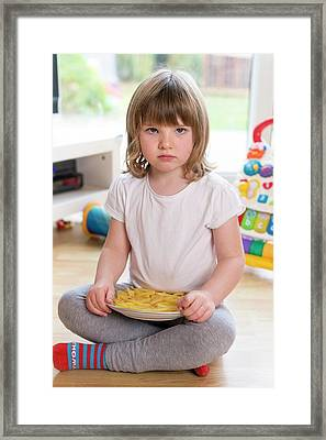 Girl Sitting On Floor With French Fries Framed Print by Aberration Films Ltd