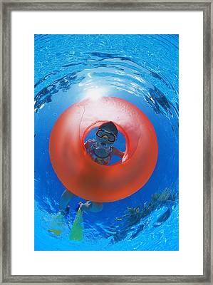 Girl Snorkeling Framed Print by Carson Ganci