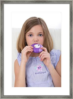 Girl Using Asthma Medication Framed Print