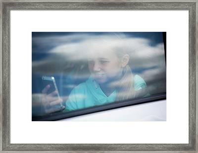 Girl Using Smartphone In Car Framed Print by Samuel Ashfield