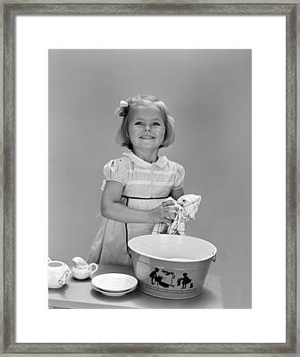 Girl Washing Dishes And Smiling, C.1940s Framed Print by H. Armstrong Roberts/ClassicStock