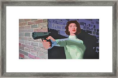 Girl With A Gun Framed Print by Geoff Greene