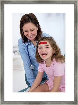 Girl With A Plaster On Forehead Framed Print