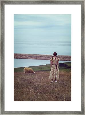 Girl With A Sheep Framed Print by Joana Kruse