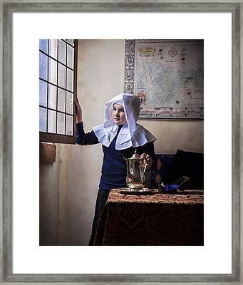 Girl With A Water Pitcher Framed Print by Levin Rodriguez