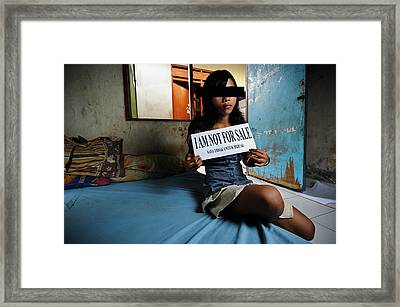 Girl With Sign Framed Print