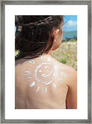 Girl With Suncream On Back Framed Print