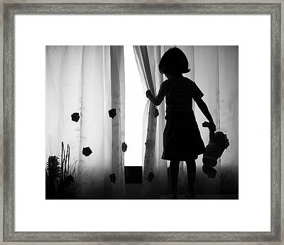 Girl With Teddy Bear In Hand Waiting For A Friend Framed Print by MQ Naufal