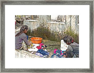 Girls Doing Laundry In The Mother's Village-nepal  Framed Print by Ruth Hager