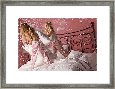 Girls Having A Pillow Fight Framed Print