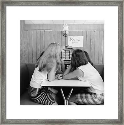 Girls Operating Small Juke Box, C.1960s Framed Print by H. Armstrong Roberts/ClassicStock