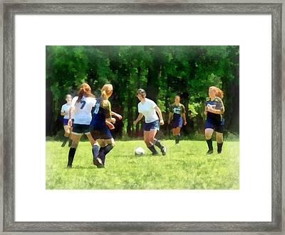 Girls Playing Soccer Framed Print by Susan Savad