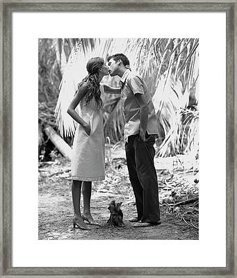 Gisele Bundchen Kissing A Young Man Framed Print by Arthur Elgort