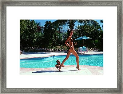 Gisele Bundchen Walking Poolside Framed Print by Arthur Elgort