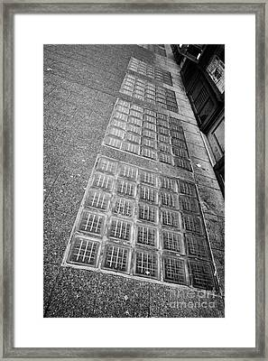 glass blocks in the sidewalk to light basement of the sam kee building in Vancouver BC Canada Framed Print