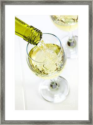 Glass Of White Wine Being Poured Framed Print by Colin and Linda McKie