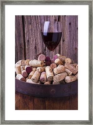 Glass Of Wine With Corks Framed Print by Garry Gay