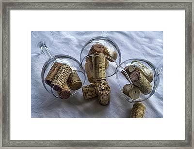 Glasses Of Corks Framed Print