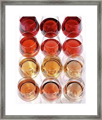Glasses Of Rose Wine Framed Print by Romulo Yanes
