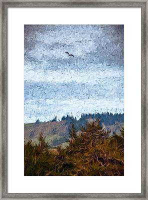 Gliding Over Firs Framed Print